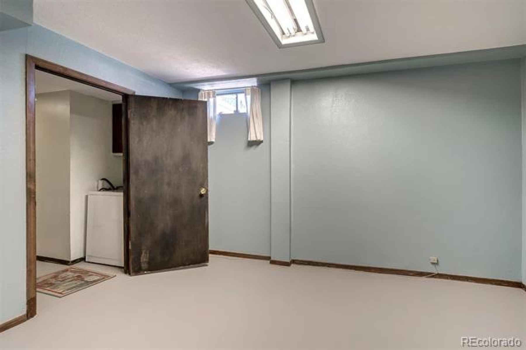 second bedroom in basement leads to laundry
