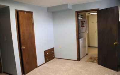 second bedroom in basement leads to laundry and 1/2 bath + shower